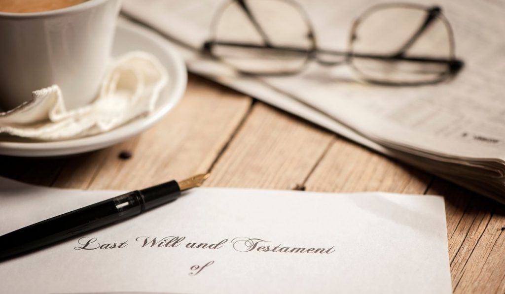 Last will and testament with cup and glasses