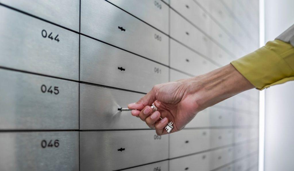 a man opening a safe deposit box