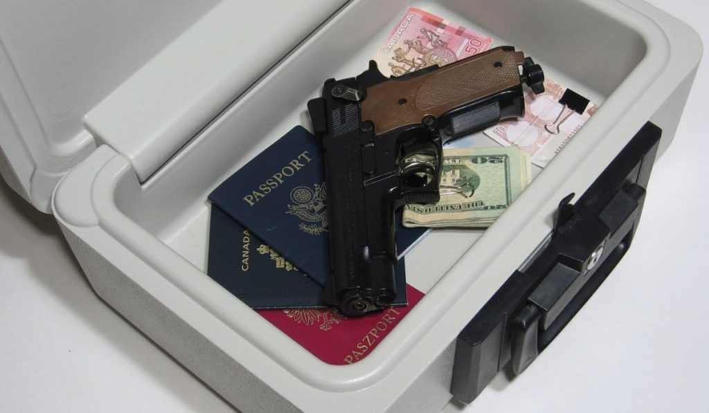 gun and passports inside the storage box