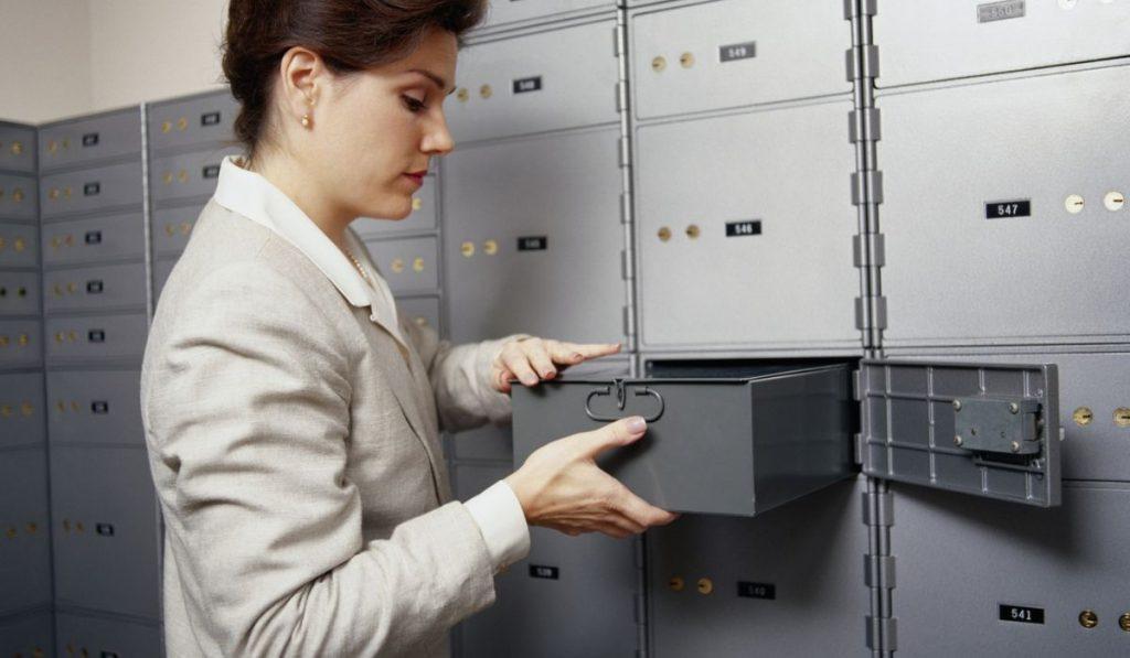 lady holding the safe deposit box