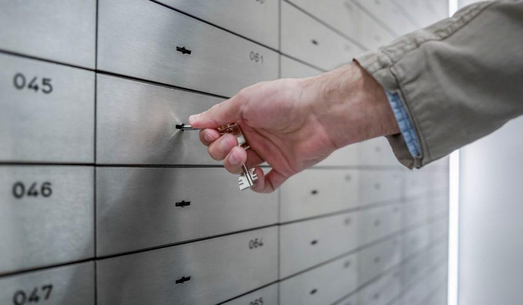 man opening a safe deposit box