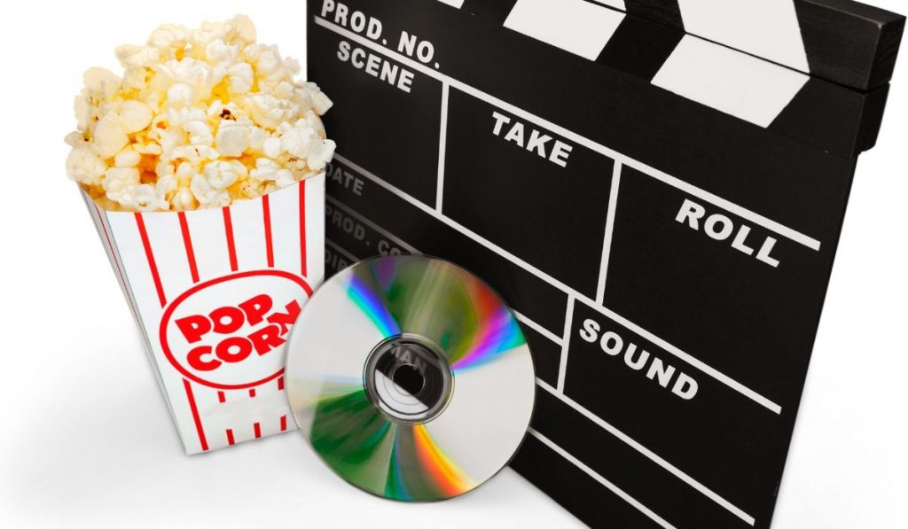 clapper, popcorn and cd
